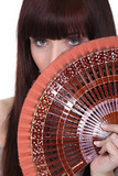 Woman holding oriental hand-fan