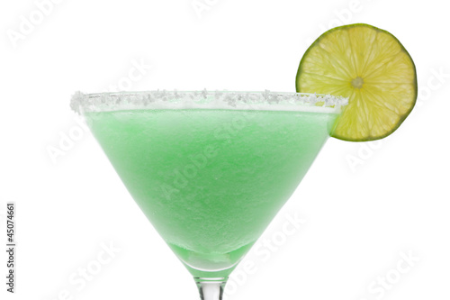 Green cocktail with lime on white background