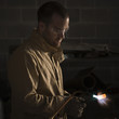 """USA, Utah, Orem, male welder using blowtorch in workshop"""