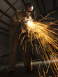 """USA, Utah, Orem, man welding metal in workshop"""
