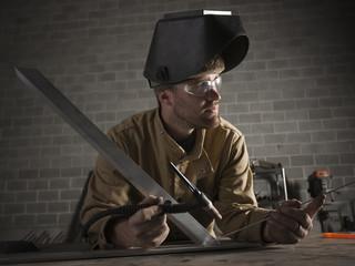 """USA, Utah, Orem, male welder in workshop"""