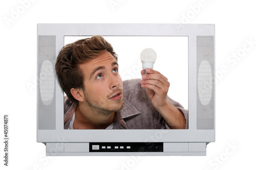 Man in television with a light bulb