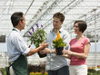 """USA, Utah, Salem, couple buying flowers from gardener"""