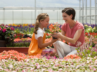 """""""USA, Utah, Salem, Mother and daughter (8-9) in plant nursery"""""""