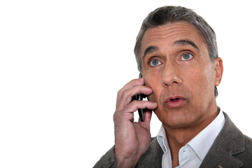 Confused man making telephone call