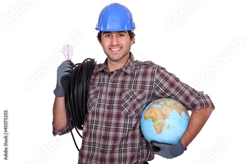 Eager electrician installing electrical systems abroad