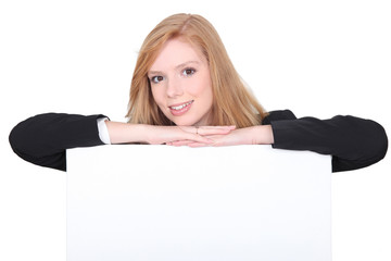 strawberry blonde girl with arms resting on canvas