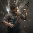 """""""Young man playing electric guitar, studio shot"""""""