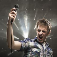 """""""Young man singing, studio shot"""""""