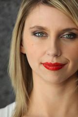 Head-shot of blond woman wearing red-lipstick