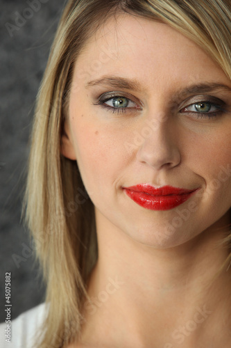 Head-shot of blond woman wearing red-lipstick