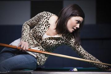 """""""USA, Utah, American Fork, young woman playing pool"""""""