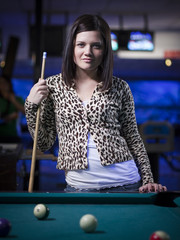 """USA, Utah, American Fork, young woman standing behind pool table"""