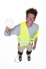 Electrocuted man holding a light bulb