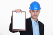 foreman showing clipboard isolated on white