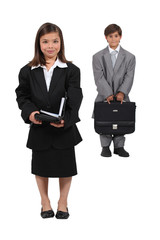 Children dressed as business people