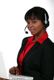 Businesswoman with a laptop and headset