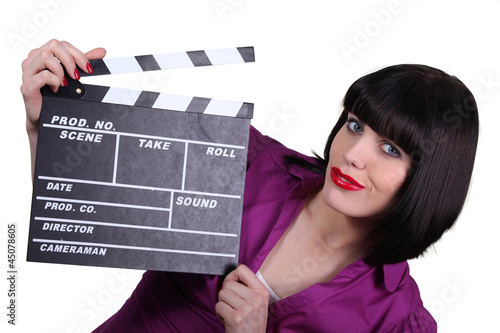 Woman holding up a clapperboard