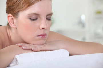 Woman with her eyes closed during a back massage