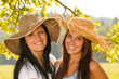 Mother and teen daughter relaxing outdoors happy