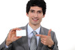 A businessman showing his card.