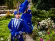 Couple in expensive dark blue costume of illusionist pose