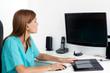 Female Dentist Using Computer