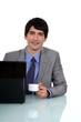 Businessman sat at desk drinking an espresso