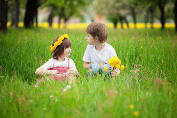 Young boy and girl in grass