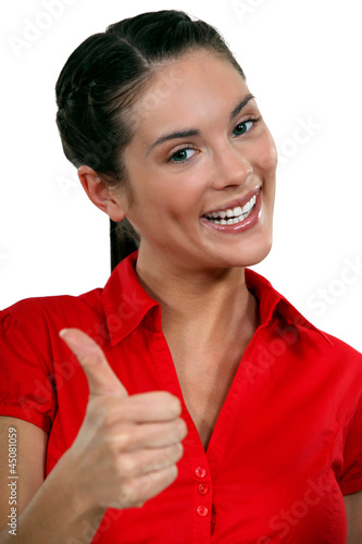 A businesswoman giving the thumb up.