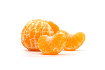 Peeled slices of tangerine on white