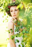Fototapety Cute woman among greenery
