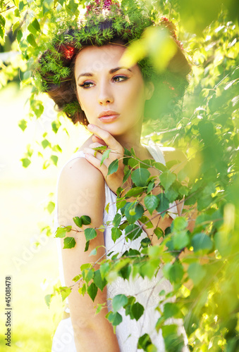 Cute woman among greenery