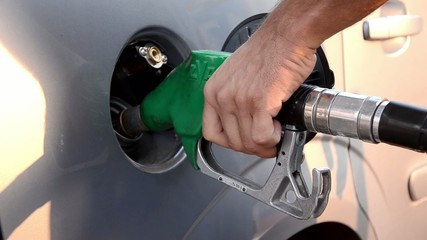 refueling a car with unleaded petrol