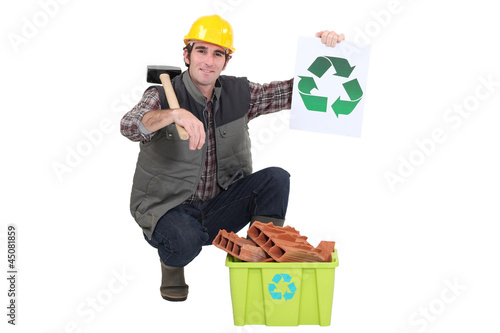 Builder recycling bricks