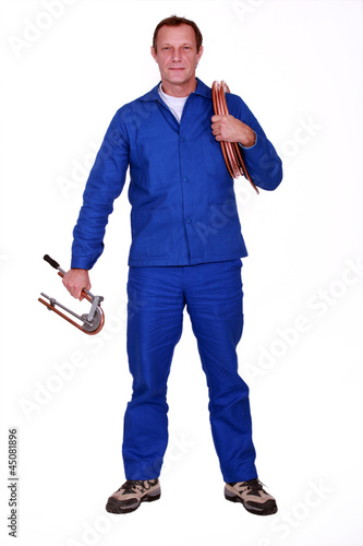 Horizontal image of man with pipe roll