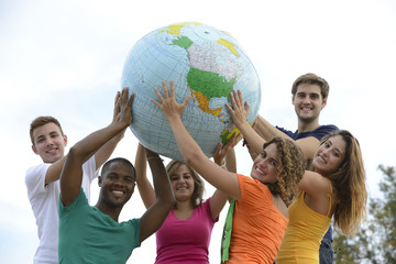 Group of young people holding a globe earth