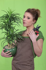 young woman holding a flowerpot