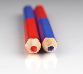 Red and blue pencils close-up isolated on white