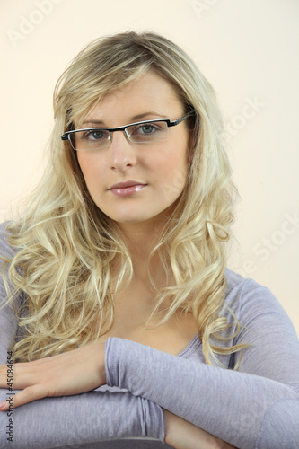 Portrait of blond woman wearing glasses
