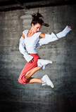 Fototapety Dancing woman with brown long hair and happy facial expression j