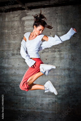 Dancing woman with brown long hair and happy facial expression j