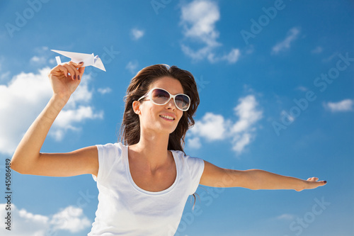 Young caucasian girl with  paper plane