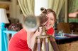 woman looking through the telescope and smiling