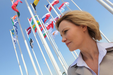 Businesswoman with flags