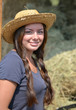 Young Beautiful Girl near a haystack