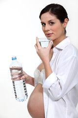 Pregnant woman drinking water