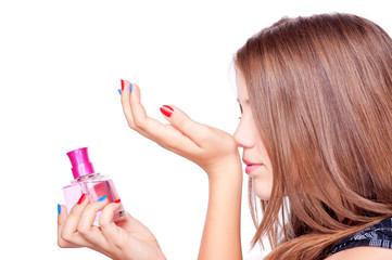 Girl smelling perfume