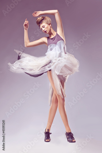 Portrait of elegant woman in retro antique era dress. Carnival
