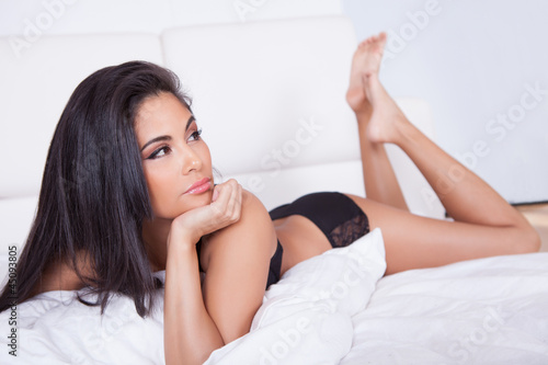 Beautiful woman relaxing in bed